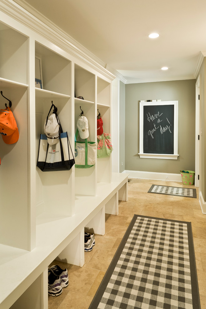 Large elegant travertine floor and brown floor mudroom photo in DC Metro with green walls