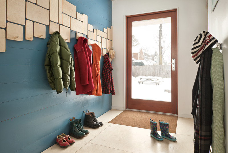 Trendy entryway photo in Portland Maine with blue walls and a glass front door