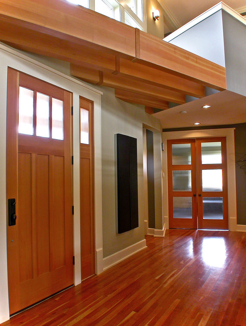 This is an example of a contemporary entrance in Seattle with a single front door and a medium wood front door.