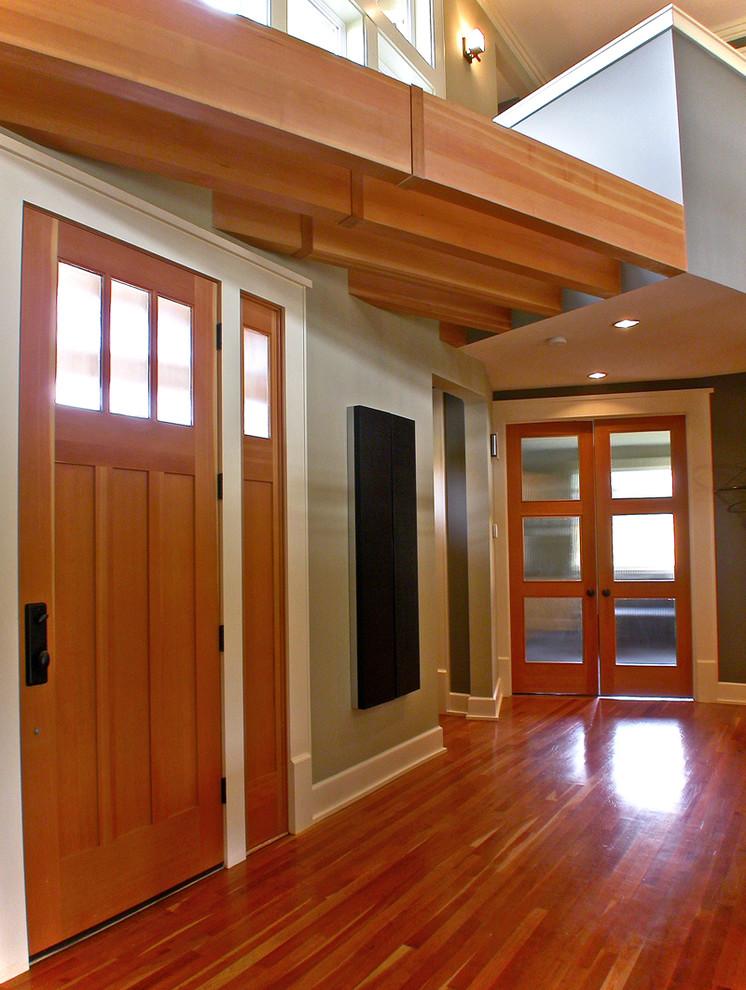 Example of a trendy single front door design in Seattle with a medium wood front door