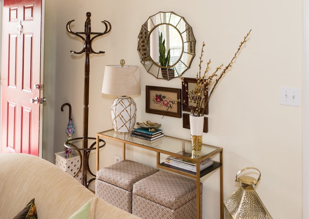 Entryway - small transitional entryway idea in Charlotte with beige walls and a red front door