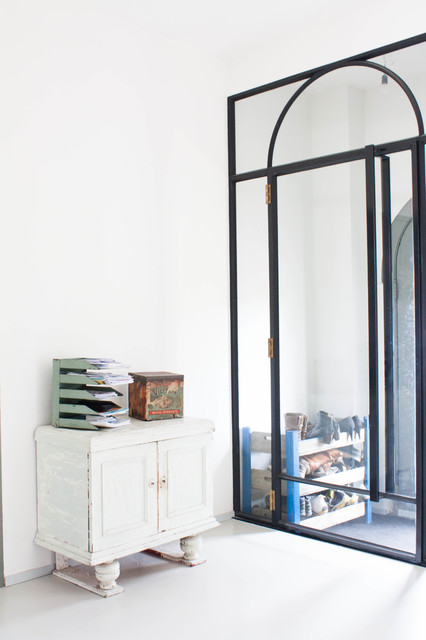 My Houzz: A Dark Storage Space transformation to a Crisp White Loft eclectic-entry