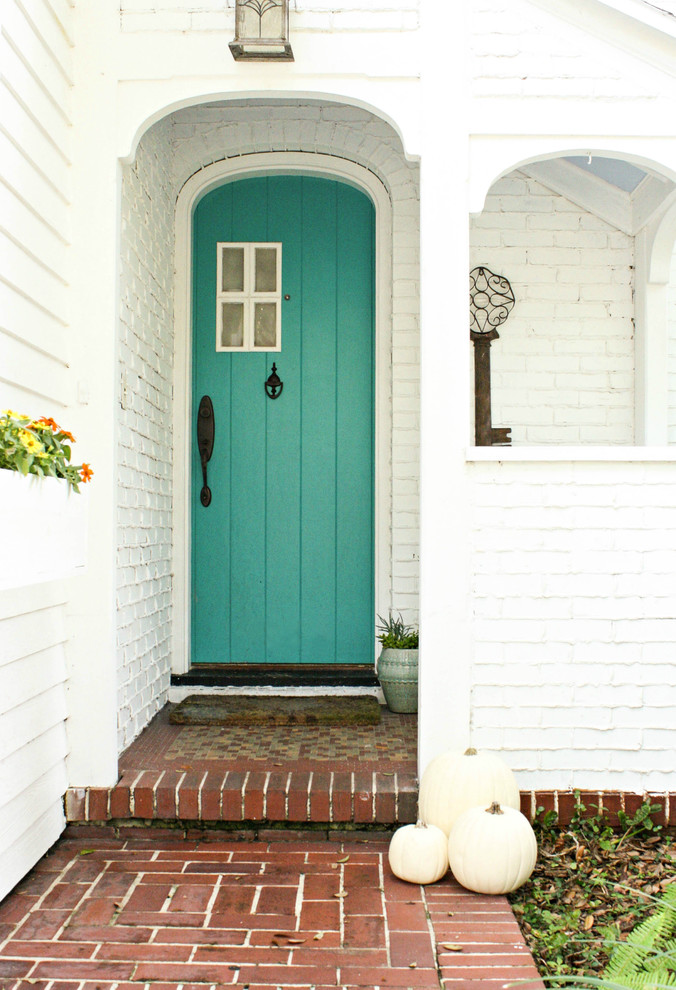 Entryway - shabby-chic style entryway idea in Tampa with a blue front door