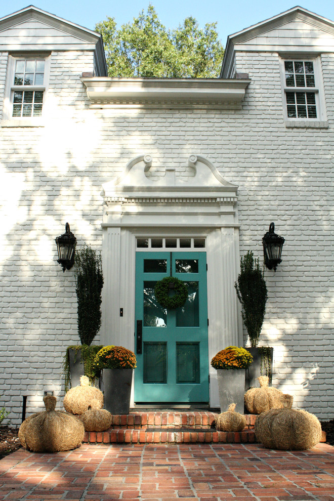 Inspiration for a timeless entryway remodel in Tampa with white walls