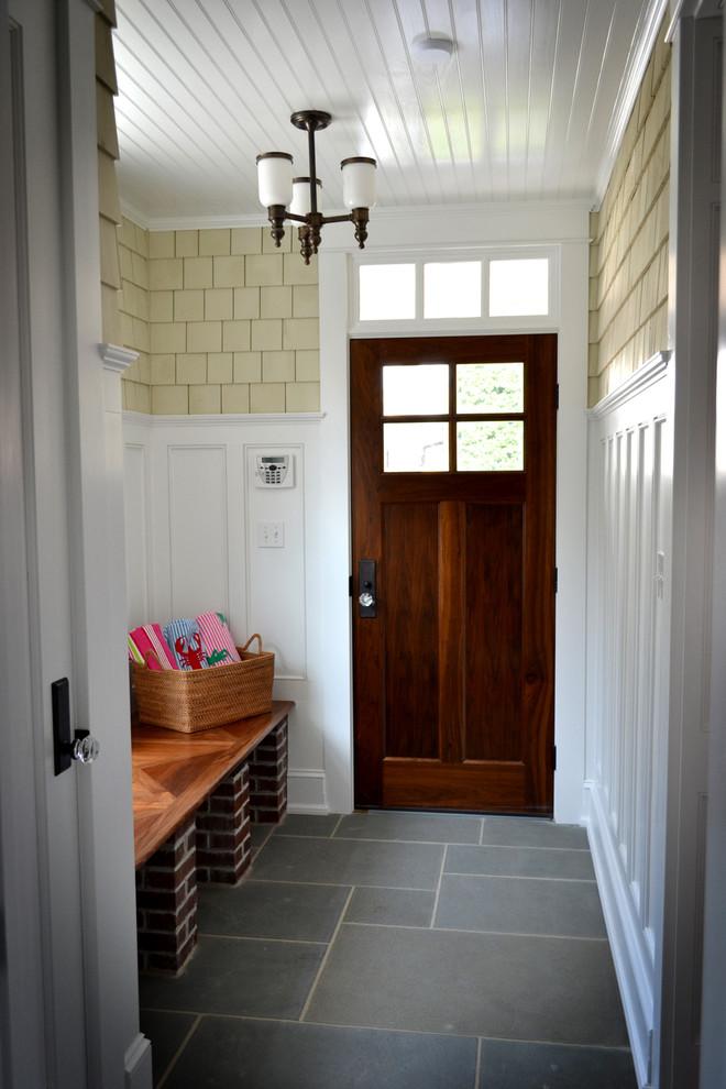 Example of a classic slate floor and gray floor entryway design in Philadelphia with a dark wood front door