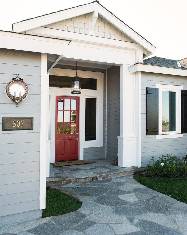 Entryway - traditional entryway idea in Orange County with a glass front door