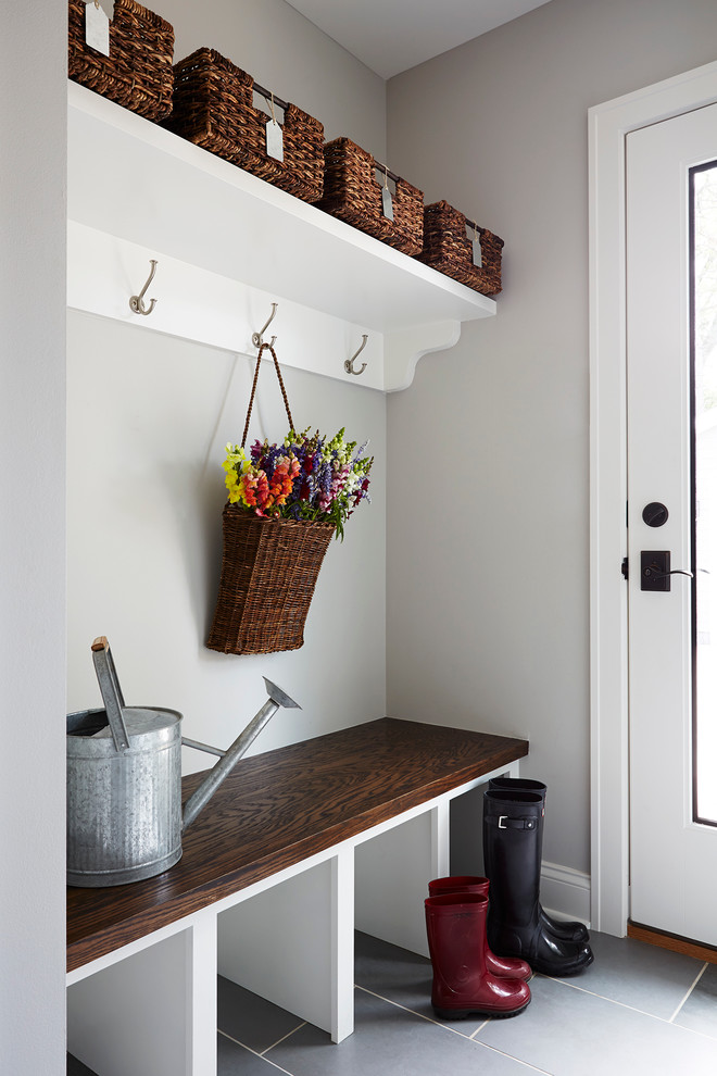 Mudroom - small transitional slate floor mudroom idea in Minneapolis with gray walls