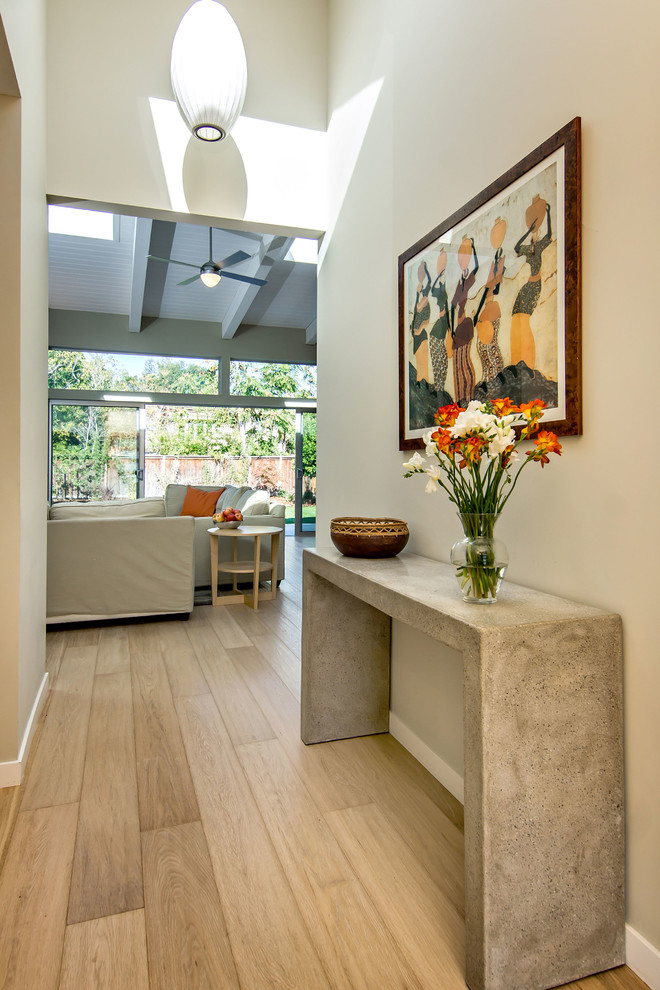 Inspiration for a mid-sized 1950s light wood floor and beige floor entry hall remodel in San Francisco with beige walls