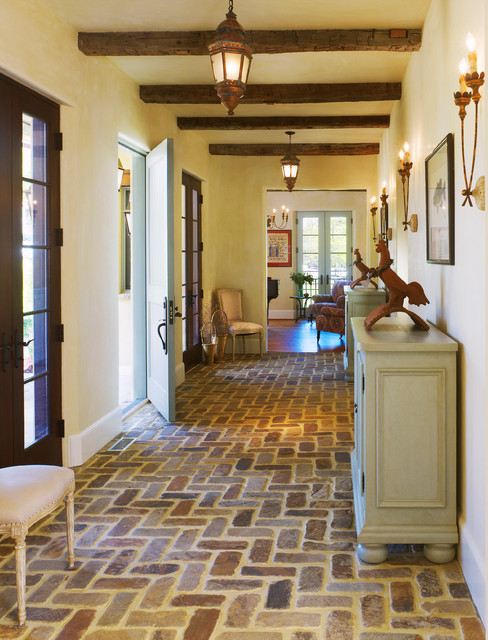 Inspiration for a mediterranean brick floor entryway remodel in DC Metro with yellow walls and a blue front door
