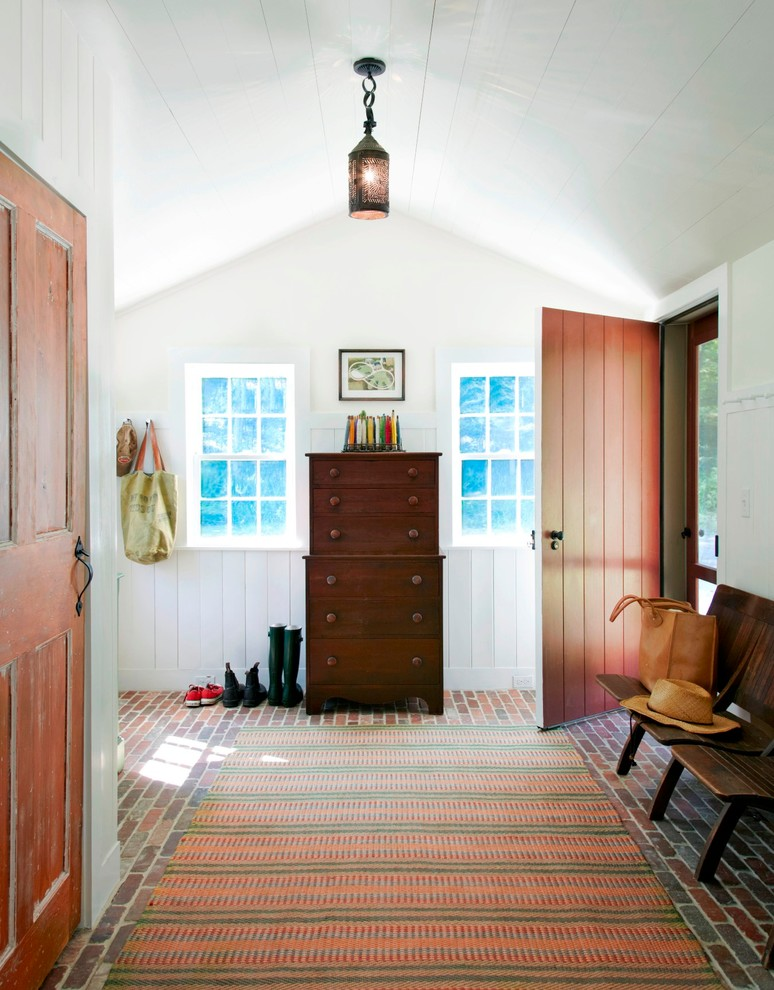 Example of a cottage brick floor and red floor entryway design in New York