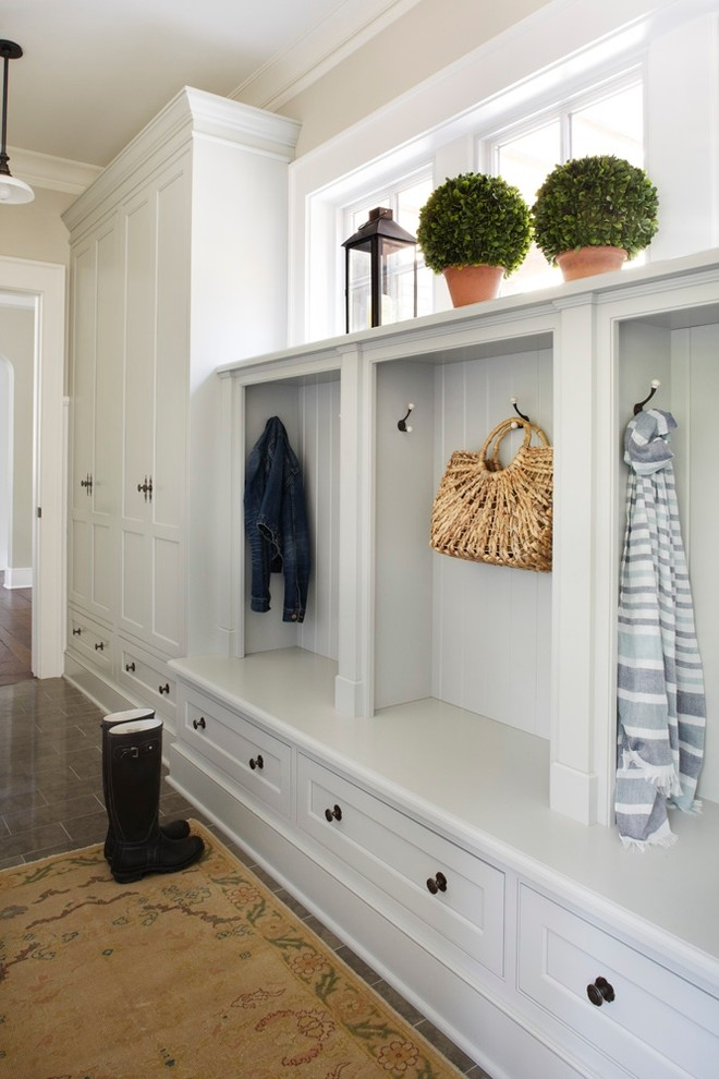 Mudroom - traditional mudroom idea in Chicago with white walls