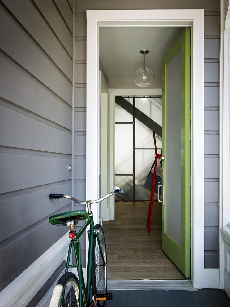 Entryway - transitional entryway idea in San Francisco with a green front door