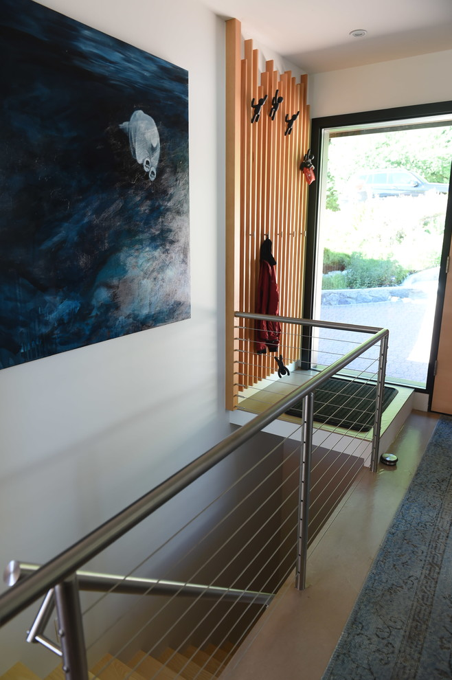 Inspiration for a small contemporary concrete floor and beige floor entryway remodel in Vancouver with white walls and a light wood front door