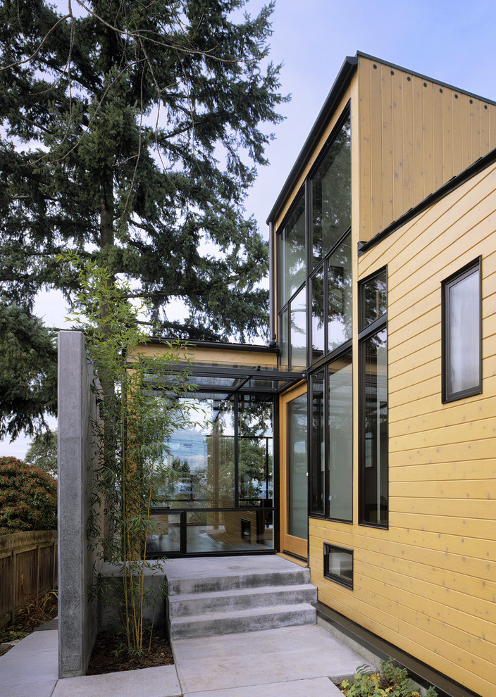 Example of a minimalist single front door design in Seattle with a glass front door