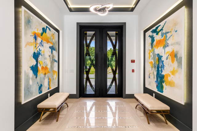 Entryway - mid-sized contemporary porcelain floor entryway idea in Orlando with white walls and a black front door