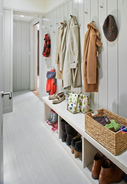 Mid-sized trendy gray floor mudroom photo in New York with gray walls