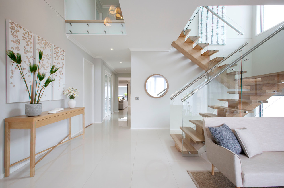 Contemporary foyer in Melbourne with white walls.