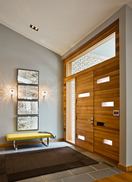 Inspiration for a modern entrance in Minneapolis with a medium wood front door and grey walls.