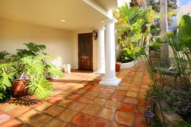 Inspiration For A Mediterranean Terra Cotta Floor And Orange Front Door Remodel In