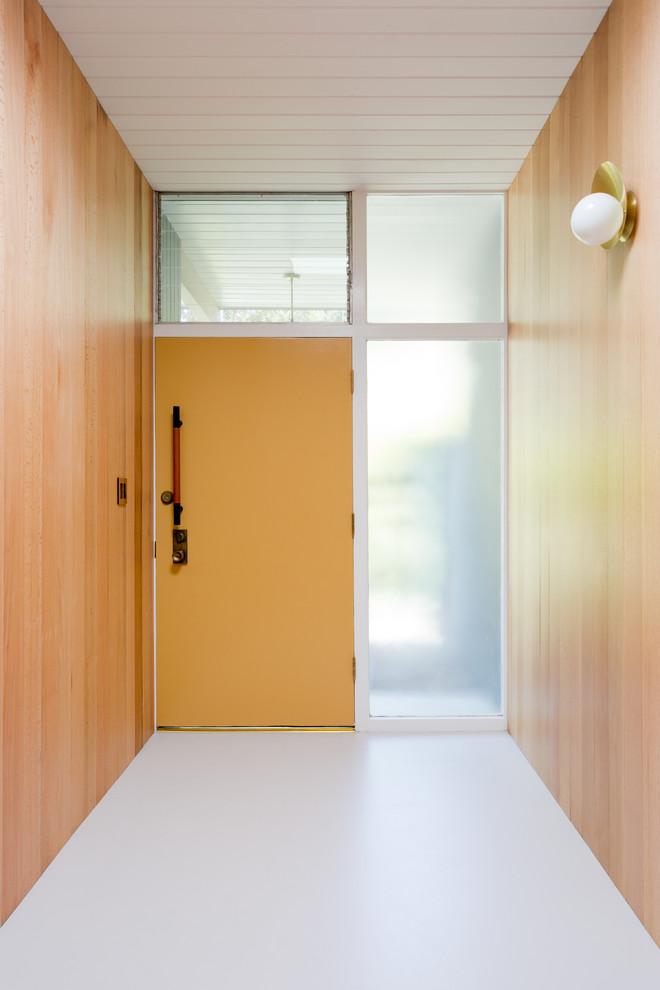1960s white floor entryway photo in Los Angeles with brown walls and an orange front door