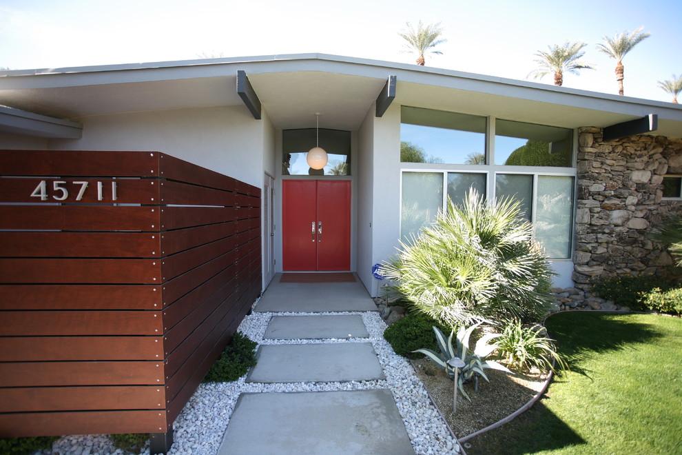 1960s double front door photo in Orange County with a red front door