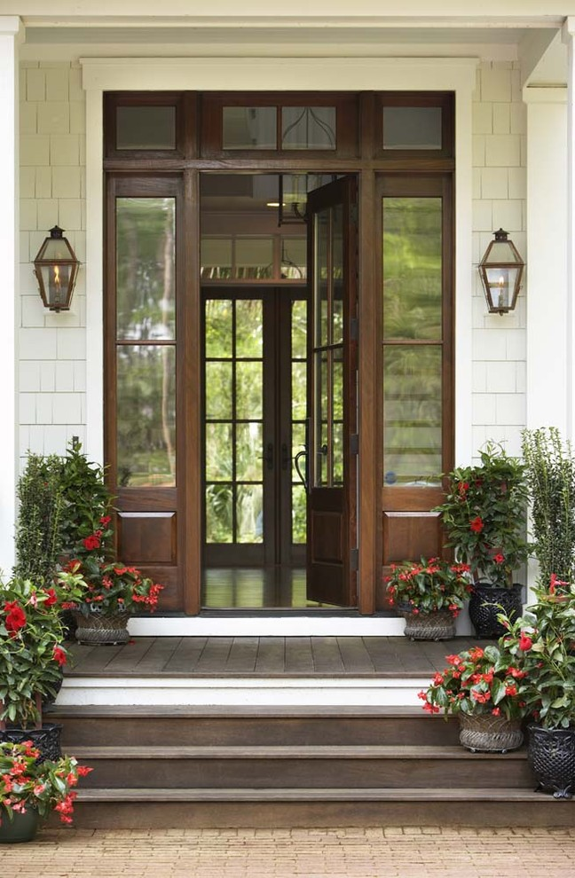 Large elegant entryway photo in Charleston with a dark wood front door