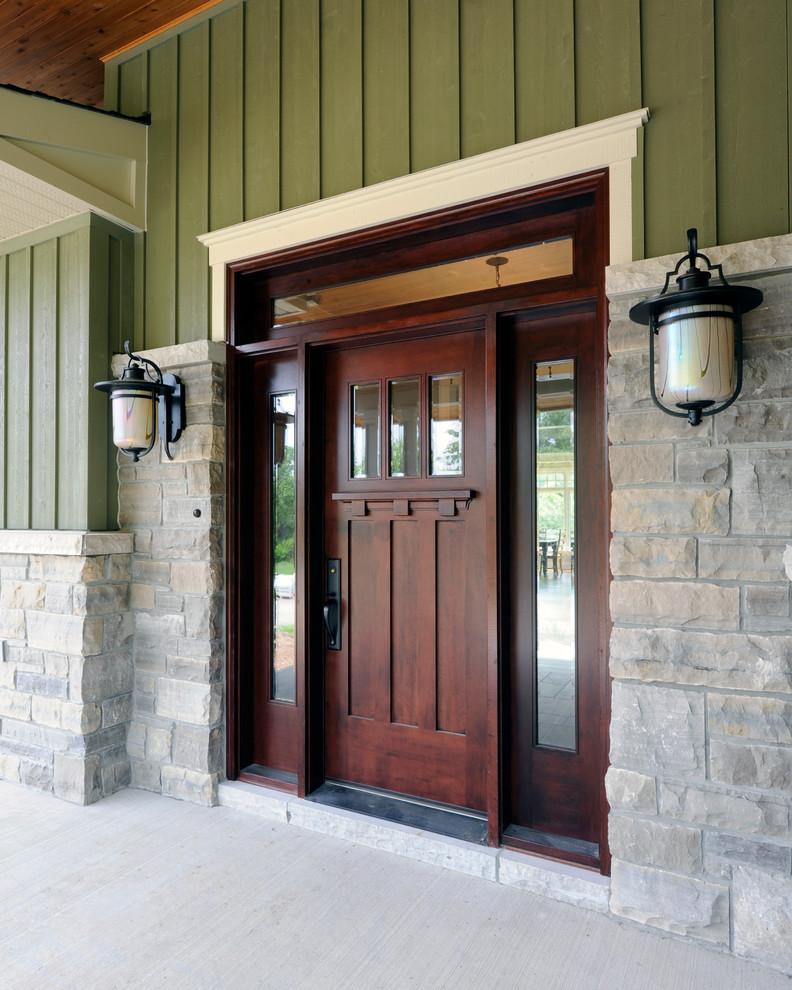 Entryway - craftsman entryway idea in Toronto with a dark wood front door