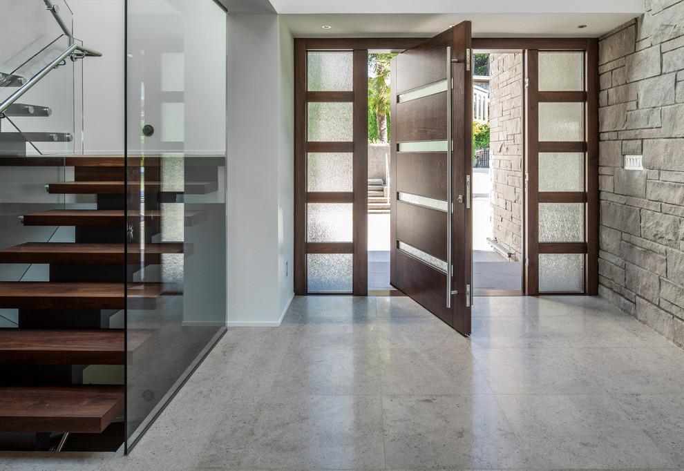 Trendy gray floor pivot front door photo in Vancouver