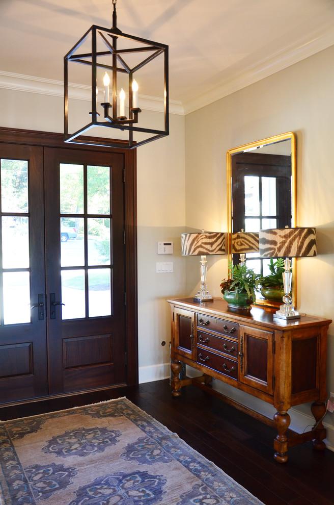 Entryway - traditional entryway idea in Miami with a dark wood front door