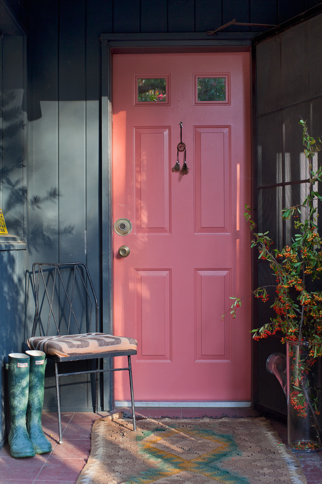 Cottage chic entryway photo with a red front door