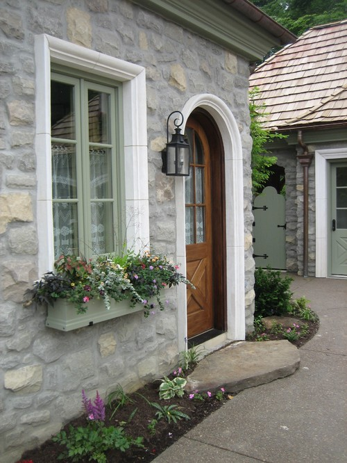 Planters outside a cottage's front door