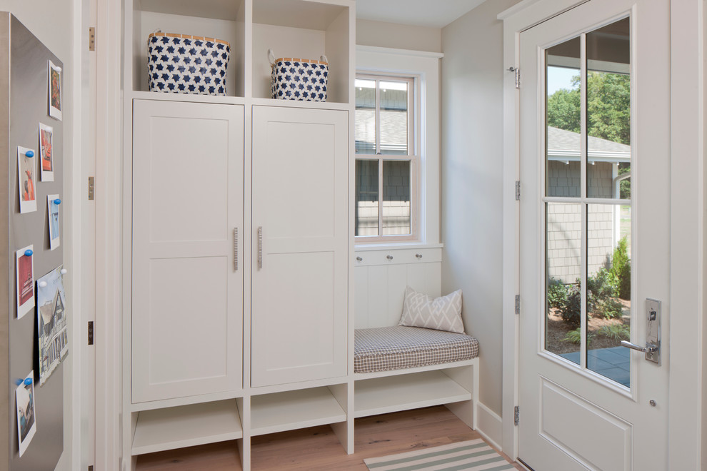 Inspiration for a beach style mudroom remodel in Grand Rapids