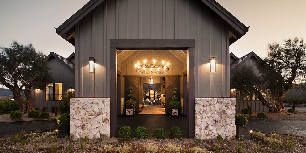 Inspiration for a large farmhouse concrete floor and beige floor entryway remodel in San Francisco with beige walls and a metal front door
