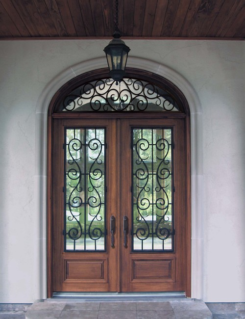Irrespective Of The Size And Design A House Wooden Doors With Intricate Designs Can Be Used As Entry Patio Also Windows