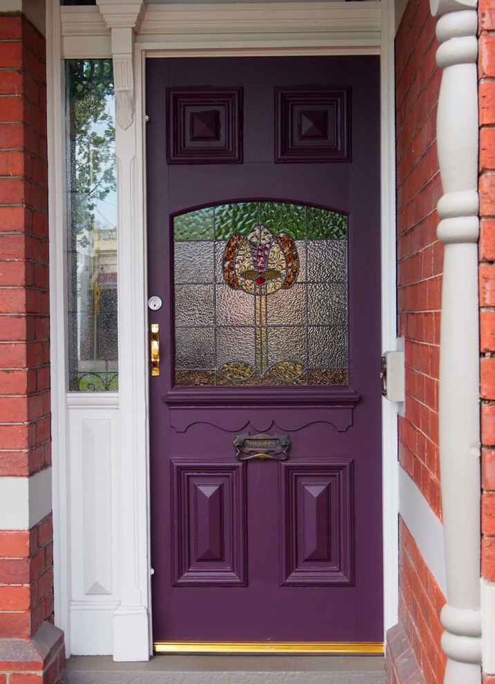 Inspiration for a timeless entryway remodel in Melbourne with a purple front door
