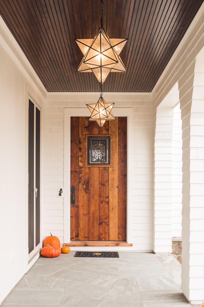 Entryway - coastal entryway idea in Portland Maine with a medium wood front door