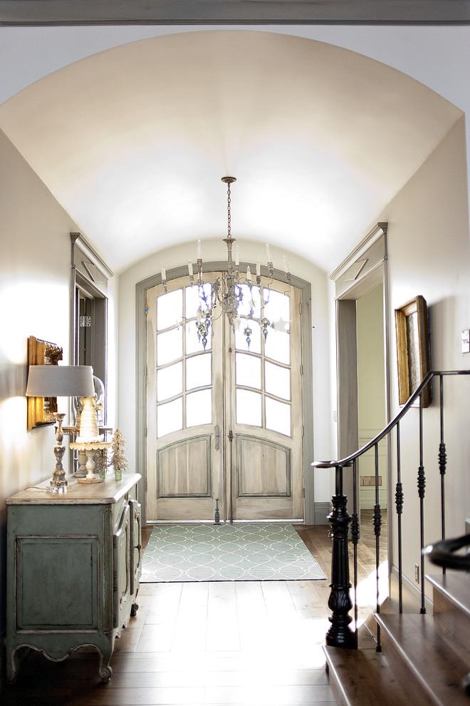 Example of a french country dark wood floor double front door design in Salt Lake City