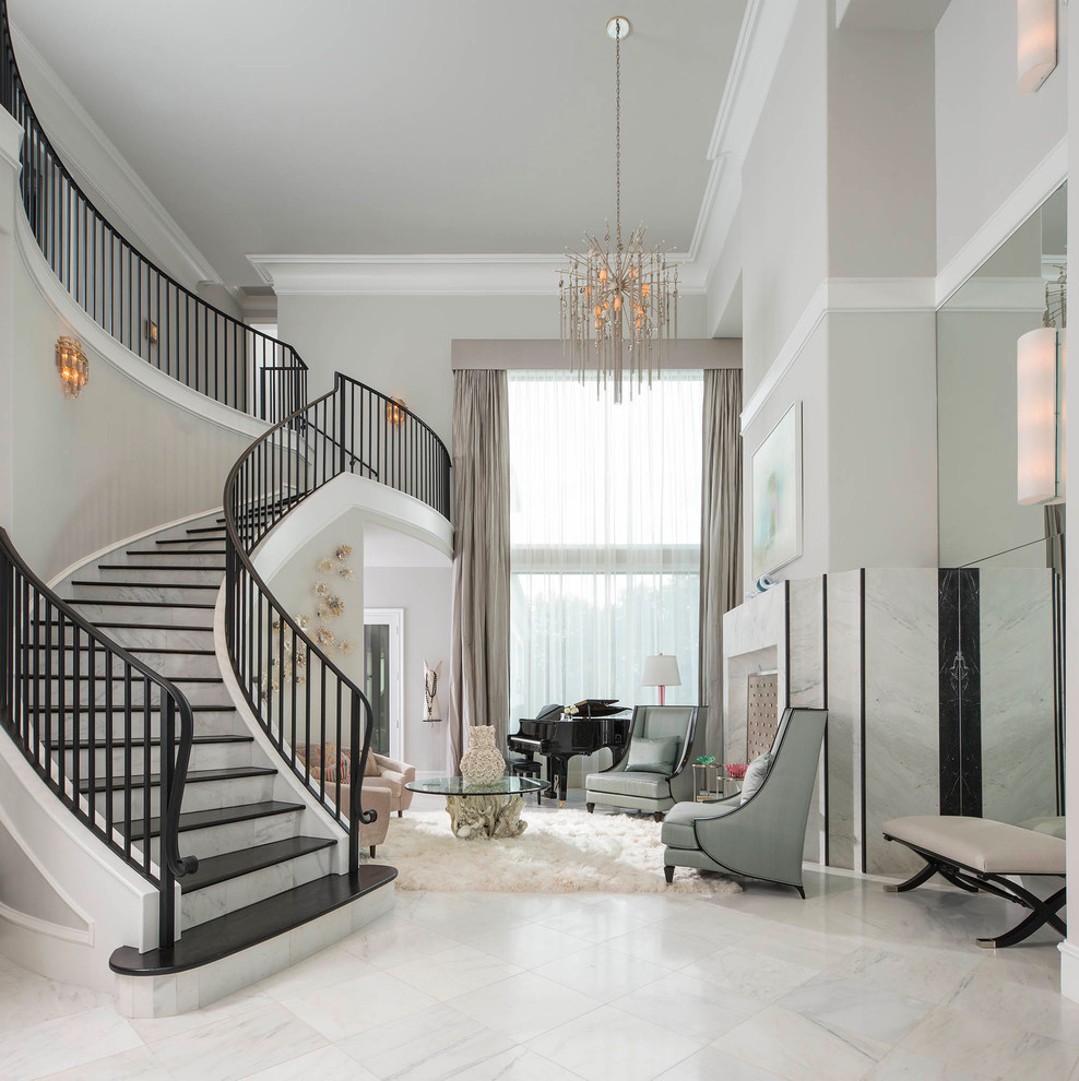 Example of a tuscan white floor foyer design in Dallas with gray walls
