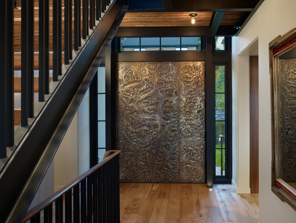 Trendy entryway photo in Seattle with a brown front door