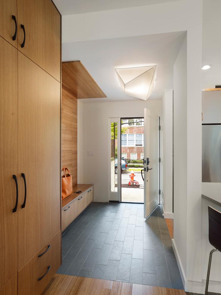Mudroom - contemporary slate floor and gray floor mudroom idea in New York with white walls