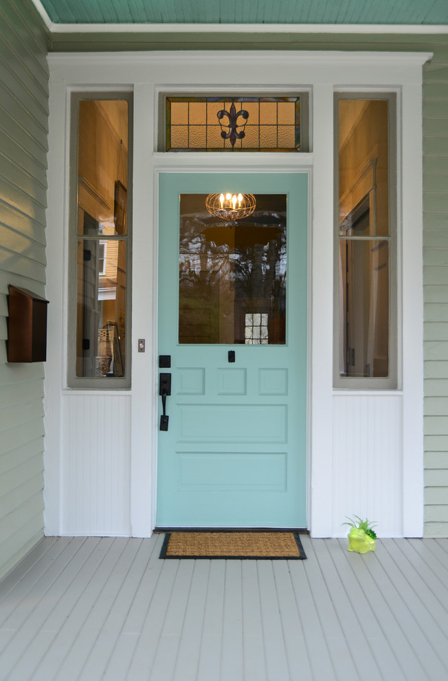 This is an example of a medium sized victorian front door in Atlanta with a single front door and a blue front door.
