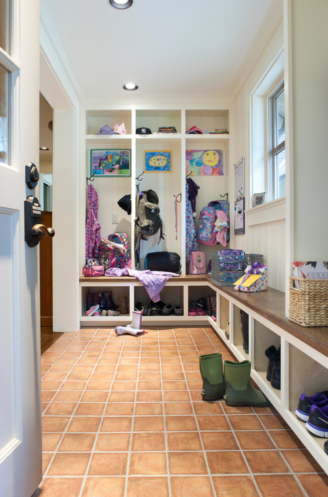 Example of a classic mudroom design in Other with white walls and a white front door