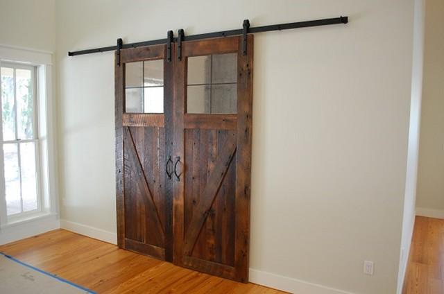 Reclaimed oak sliding barn doors rustic living room for Sliding barn door living room