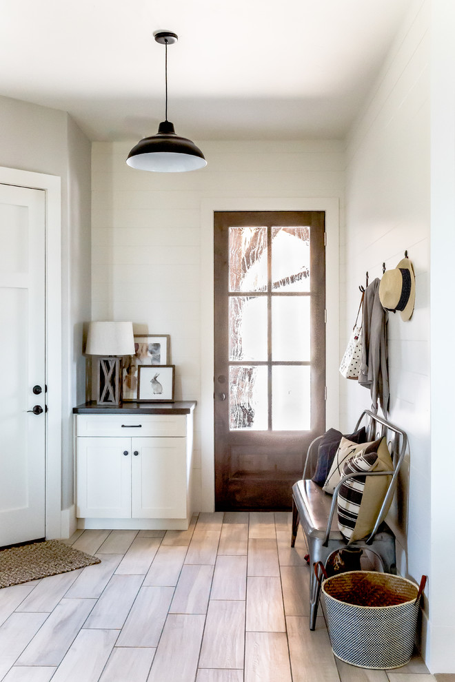 Large cottage porcelain floor entryway photo in Salt Lake City with white walls and a white front door