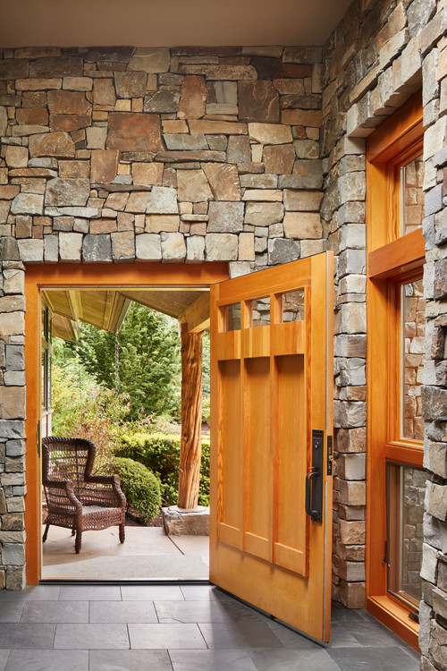 Stone walls and accents anchor this Redmond home design.