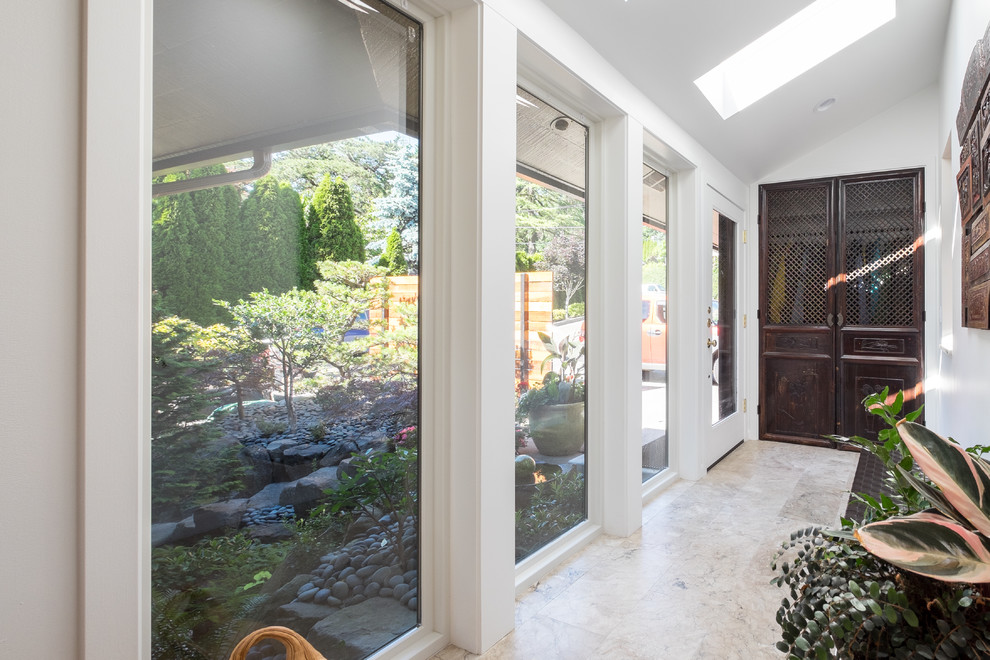 Entryway - mid-sized transitional marble floor entryway idea in Portland with white walls and a glass front door