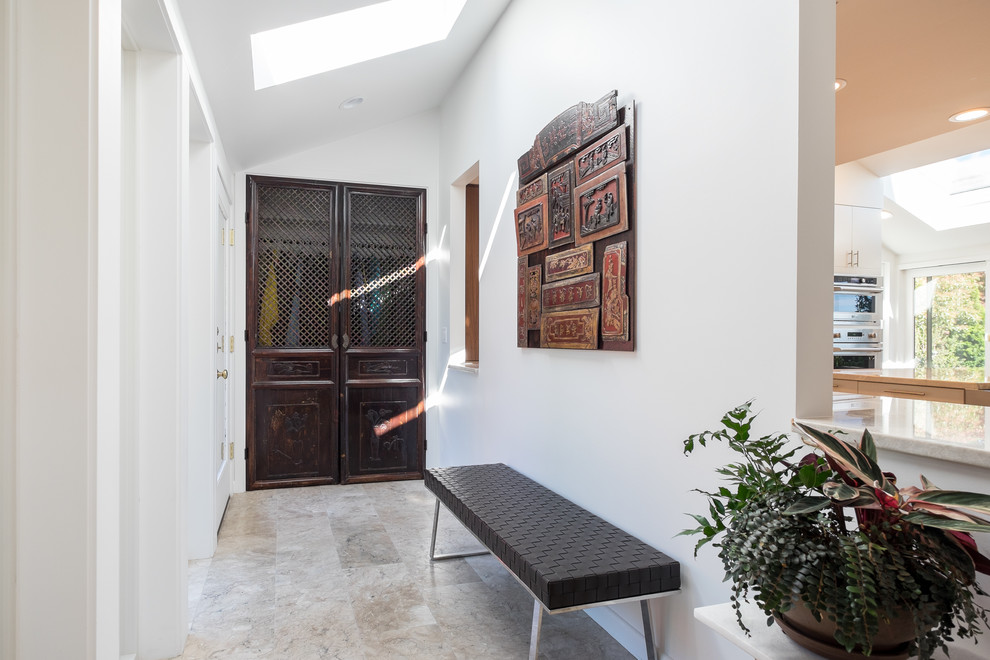 Mid-sized transitional marble floor entryway photo in Portland with white walls and a glass front door