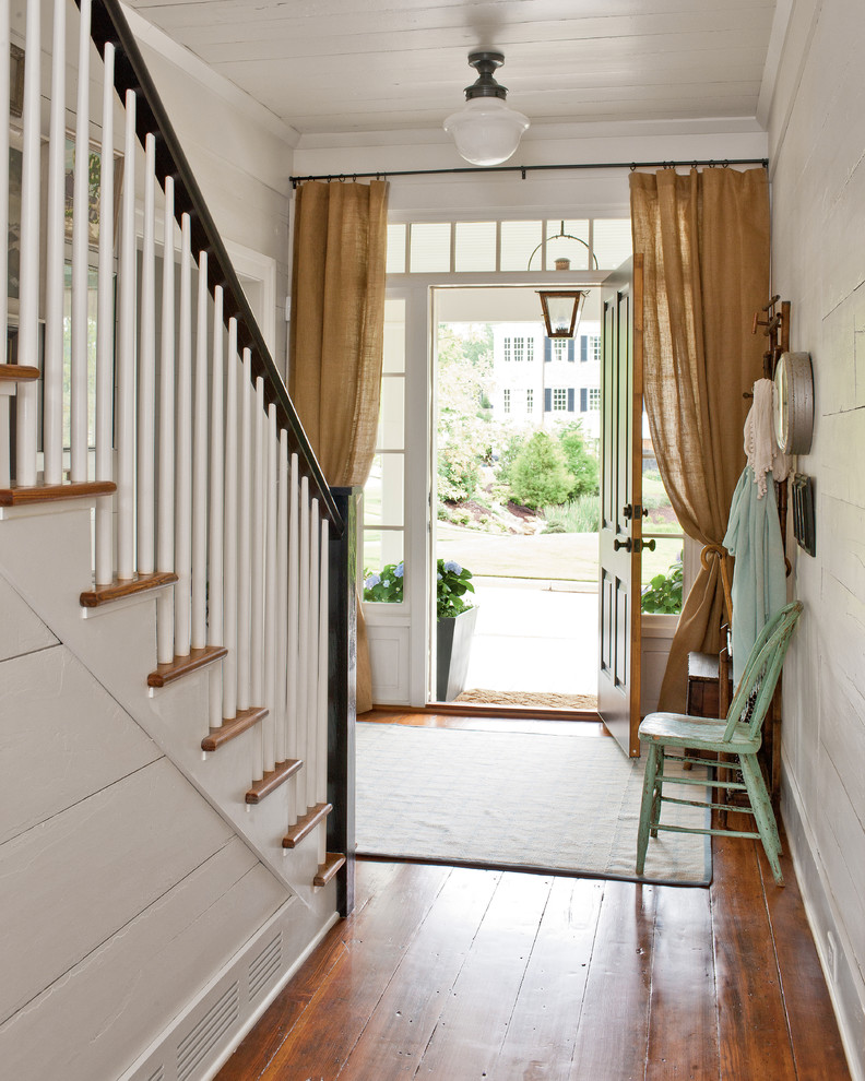 Entry hall - cottage entry hall idea in Atlanta with white walls