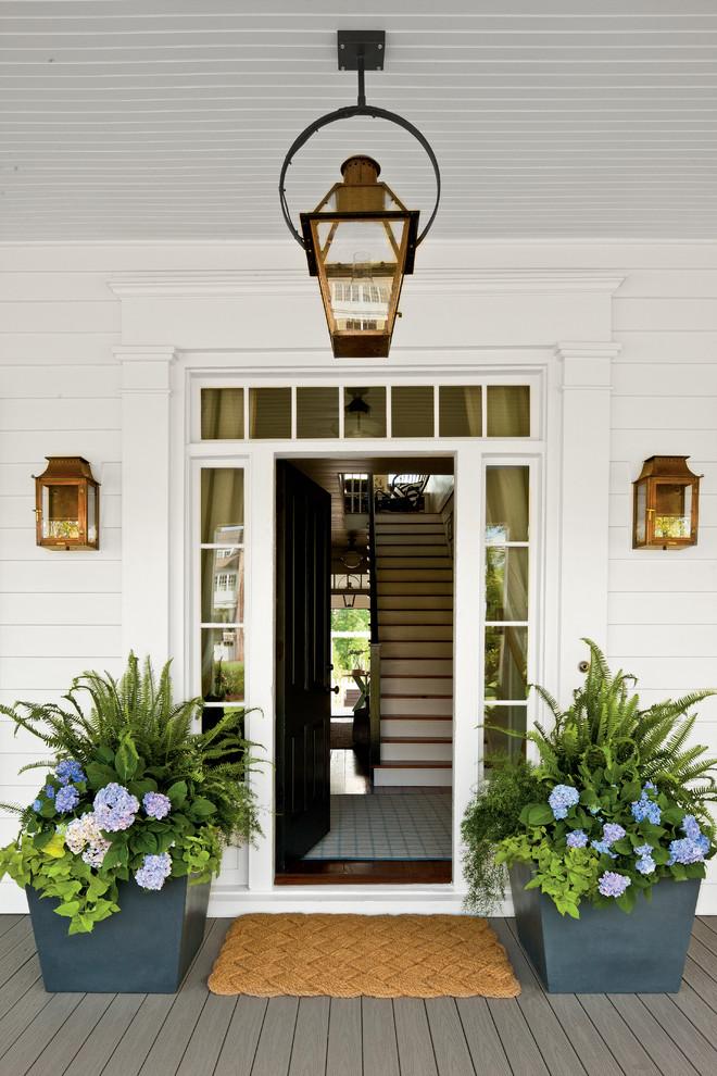 Example of a country entryway design in Atlanta with a black front door