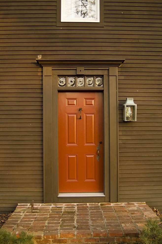 Example of a classic entryway design in Cincinnati with a red front door